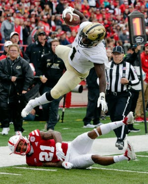 Purdue running back D.J. Knox (1) leaps over Nebraska defensive back Lamar Jackson (21), during the first half of an NCAA college football game in Lincoln, Neb., Saturday, Sept. 29, 2018. (AP Photo/Nati Harnik)