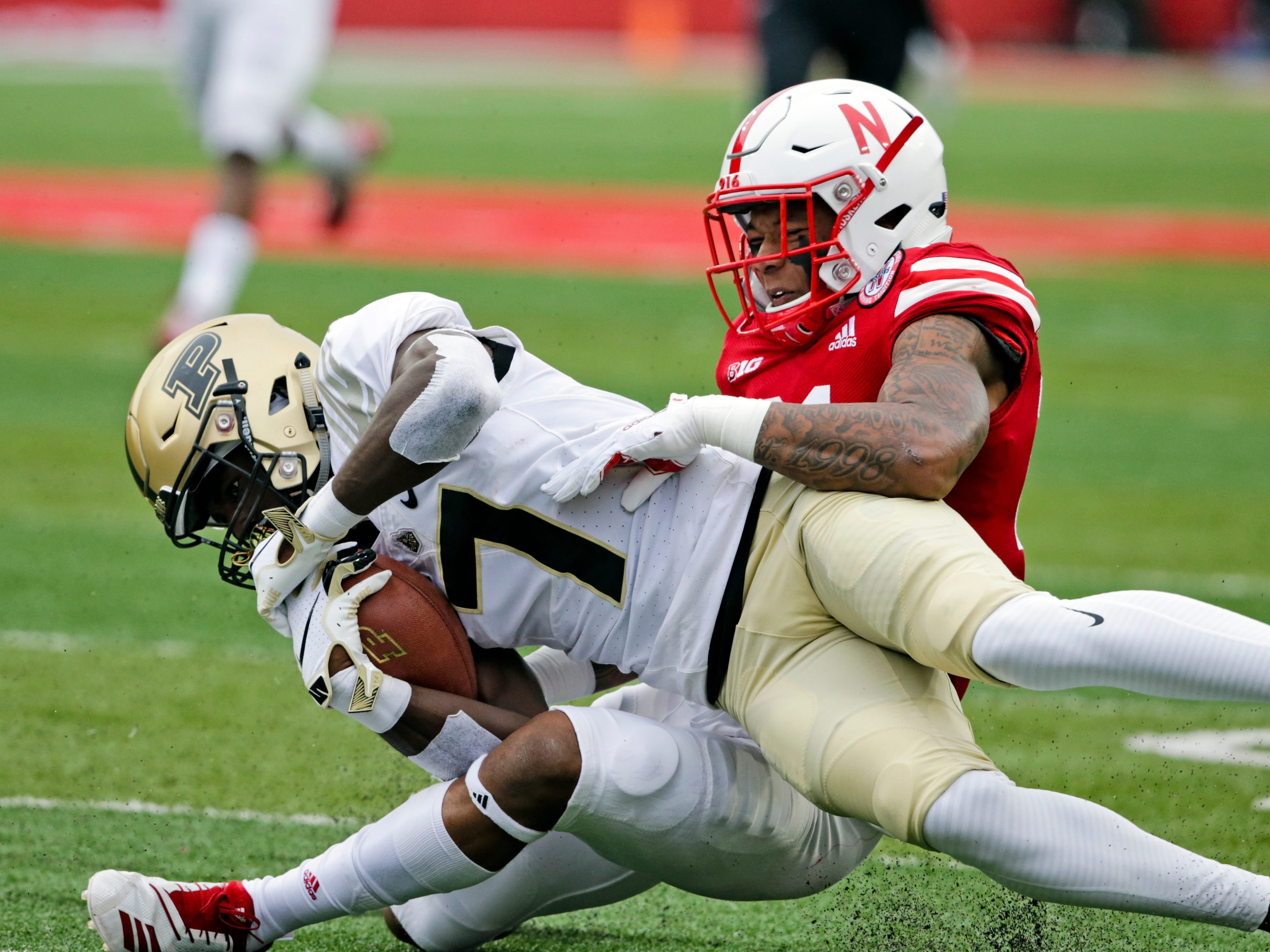 Nebraska defensive back Lamar Jackson (21) tackles Purdue wide receiver Isaac Zico (7) during the first half of an NCAA college football game in Lincoln, Neb., Saturday, Sept. 29, 2018. (AP Photo/Nati Harnik)