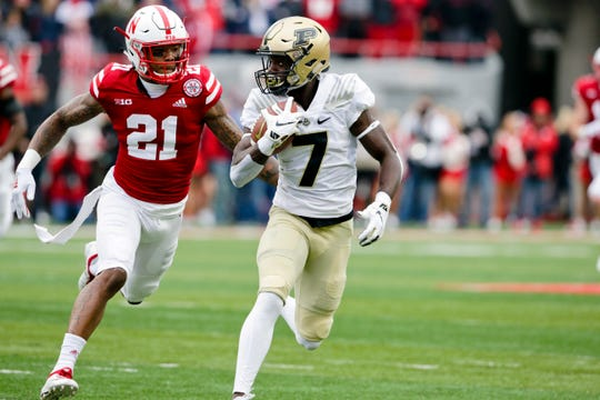 Purdue wide receiver Isaac Zico (7) runs away from Nebraska defensive back Lamar Jackson (21) during the first half of an NCAA college football game in Lincoln, Neb., Saturday, Sept. 29, 2018. (AP Photo/Nati Harnik)
