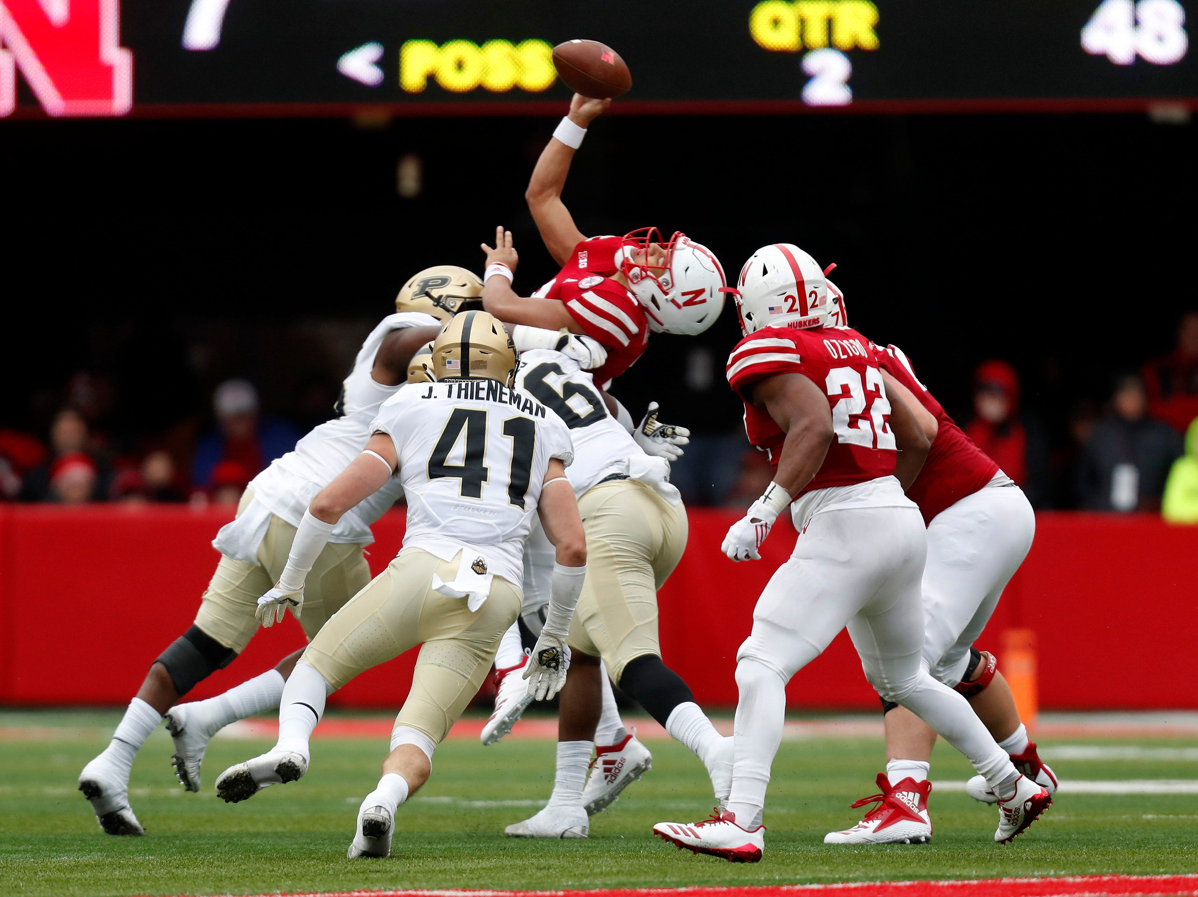 Sep 29, 2018; Lincoln, NE, USA; Nebraska Cornhuskers quarterback Adrian Martinez (2) is tackled as he gets the pass off against the Purdue Boilermakers in the first half at Memorial Stadium. Mandatory Credit: Bruce Thorson-USA TODAY Sports