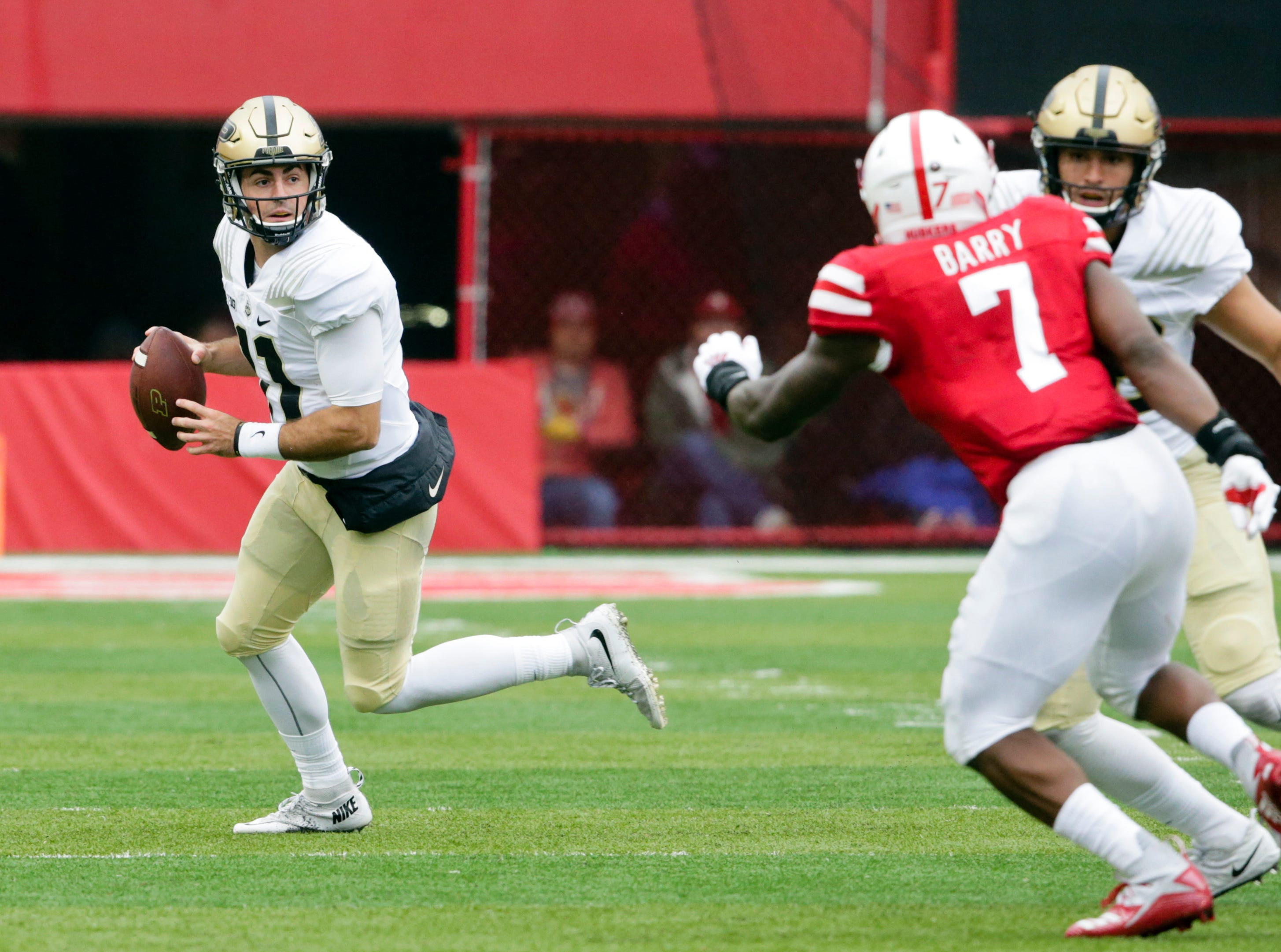 Purdue quarterback David Blough (11) looks for a receiver during the first half of an NCAA college football game against Nebraska in Lincoln, Neb., Saturday, Sept. 29, 2018. (AP Photo/Nati Harnik)