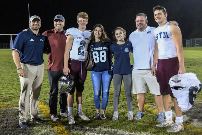 St. Thomas More freshman quarterback Walker Howard (2) is surrounded by uncle, aunt, cousins and friends following Friday's win at Franklinton. Howard's mother, Kathryn, died of cancer on Thursday. His father, Jamie, played quarterback at St. Thomas More in the early 1990s and was the quarterback at LSU.