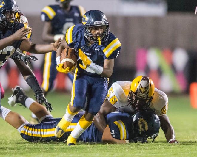Carencro's Artrell Marks (2) runs for a big gain as the Bears play host to McDonogh 35 for Homecoming Friday Sept. 28, 2018.