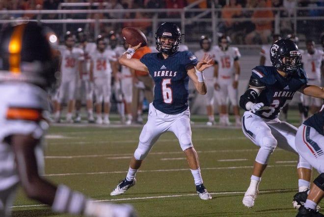 Teurlings quarterback Sammy Leblanc throws a touchdown pass as the Teurlings Catholic Rebels take on the Catholic High School Bears on Sept. 28, 2018.