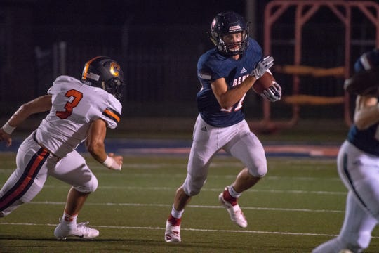 Teurlings Catholic running back Landon Trosclair, shown here hitting the hole against  Catholic High of Baton Rouge earlier this season, has gone from an unknown transfer to a workhorse back for the Rebels.
