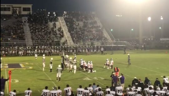 St. Thomas More's offense takes a knee on its first play from scrimmage in honor of the death of the mother of freshman quarterback Walker Howard.