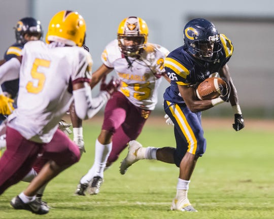 Carencro's Trejun Jones (26) gets to the outside to score for the Bears' first touchdown against McDonogh 35 Friday Sept. 28, 2018.