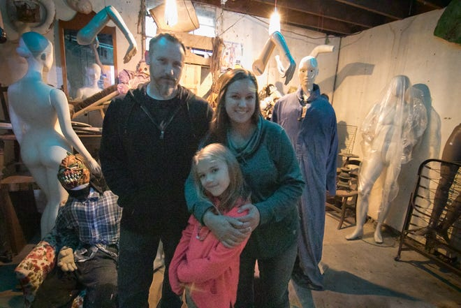 Mike and Jen Bilski, posing with their 6-year-old daughter Grace Friday, Sept. 28, 2018, are the new owners of Putnam Township's Terrorfied Forest.