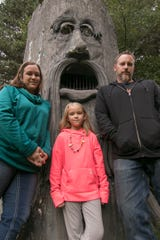 Jen and Mike Bilski, shown Friday, Sept. 28, 2018 with their 6-year-old daughter Grace, are the new owners of the Terrorfied Forest in Putnam Township.