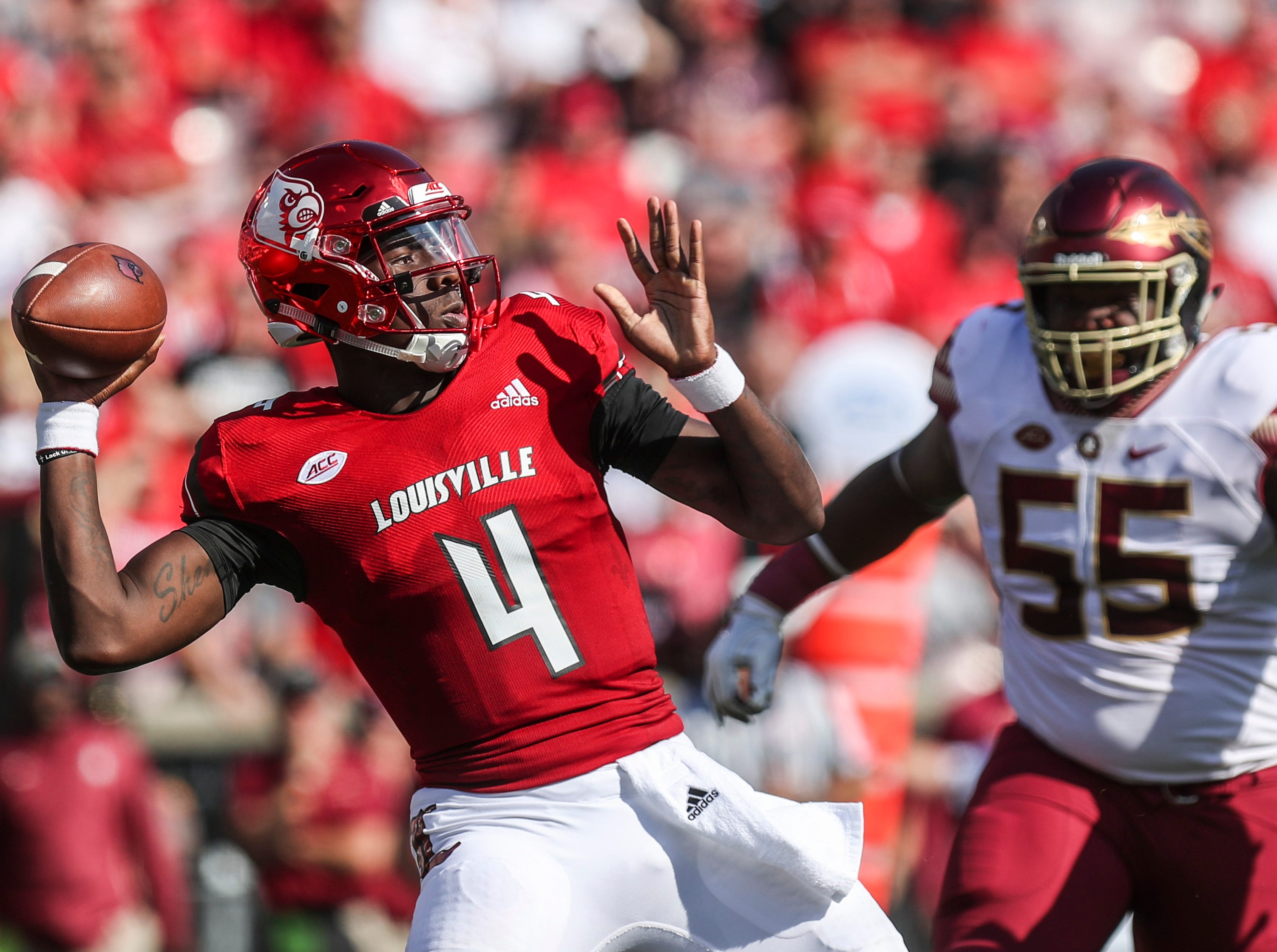 Louisville's Jawon Pass looks to pass in the first half against Florida State Saturday afternoon. Sept. 29, 2018