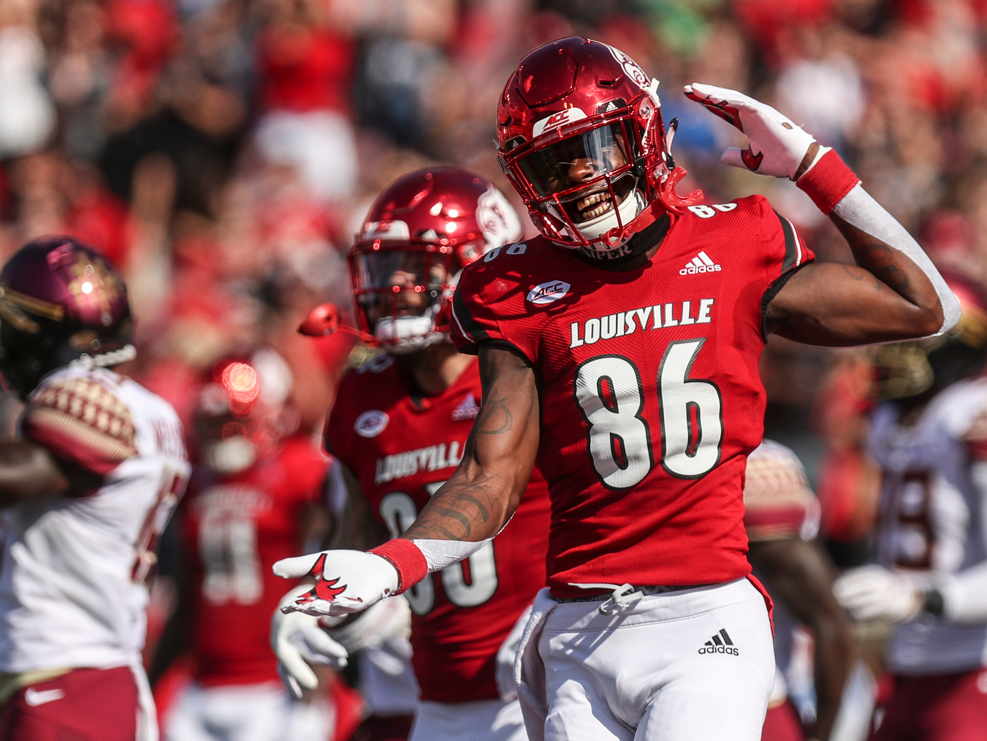 Louisville's Devante Peete celebrates quarterback Juwan Pass' touchdown run in the first half against Florida State Saturday afternoon. Sept. 29, 2018