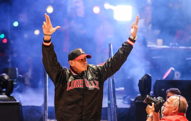 Louisville men's basketball head coach Chris Mack was introduced to the crowd with a vintage Starter jacket look from the 1980s to cheers at the Louisville Life event on Fourth Street Live!.  Sept. 28, 2018