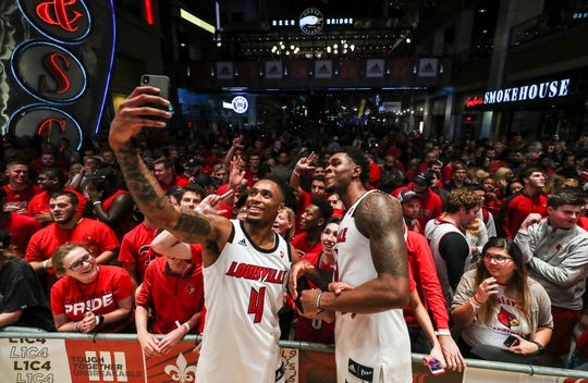 Louisville's Khwan Fore and V.J. King pose with the fans after the basketball pep rally on Fourth Street Live!. Around 7,500 people were packed around the stage. Sept. 28, 2018