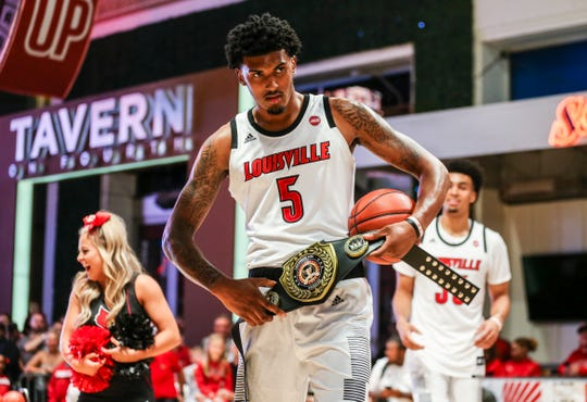 Malik Williams (5) playfully stole the 3-point champion belt at Louisville Live.