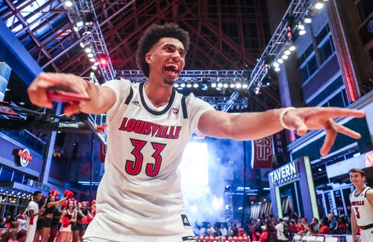 Jordan Nwora smiles with fans at the Louisville Live rally.