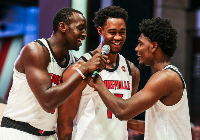 Louisville's Akoy Agua kidded around with freshman Darius Perry the basketball pep rally on Fourth Street Live!.  Sept. 28, 2018