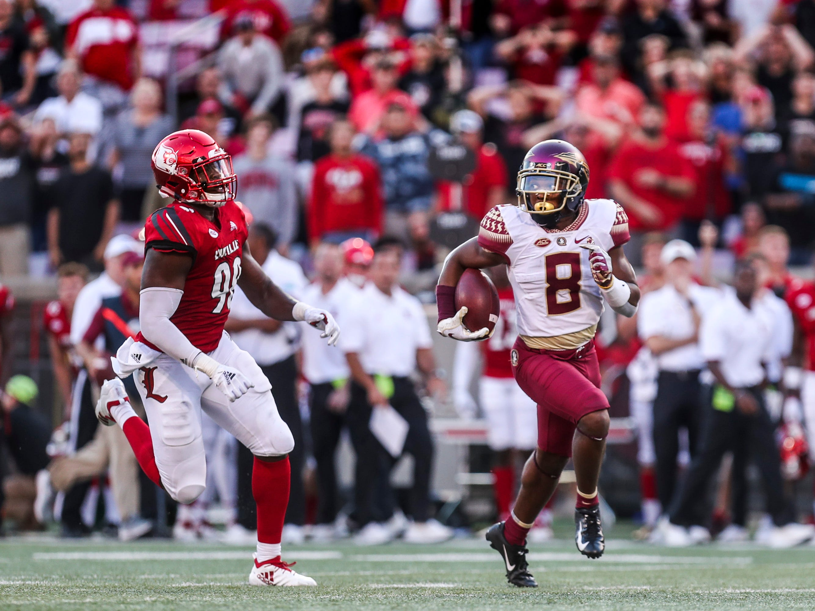 Florida State's Nyqwan Murray pulled a victory from Louisville after he ran 58 yards for a touchdown as the Seminoles came back to beat the Cardinals Saturday afternoon. Sept. 29, 2018