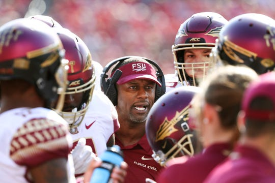 Florida State head coach Willie Taggart instructed his team against Louisville at Cardinal Stadium.