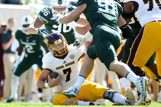 Central Michigan's Tommy Lazzaro is sacked by Michigan State's Jacub Panasiuk, center, and Jack Camper during the second quarter on Saturday, Sept. 29, 2018, at Spartan Stadium in East Lansing.