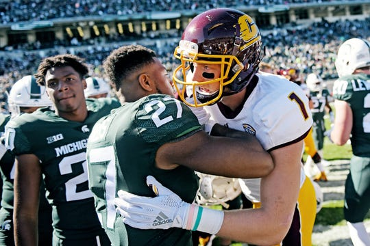 Central Michigan's Tony Poljan, right, shakes hands with Michigan State's Khari Willis after the game on Saturday, Sept. 29, 2018, at Spartan Stadium in East Lansing. Poljan played for Lansing Catholic in high school.