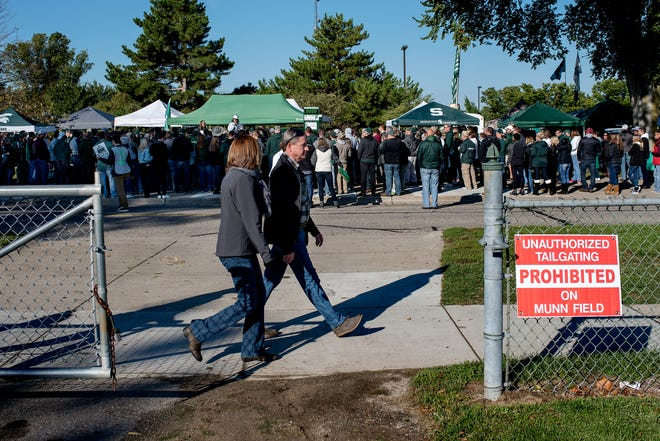 Michigan State fans tailgate on the other side of Munn Field before the Spartans game against Central Michigan on Saturday, Sept. 29, 2018, in East Lansing.