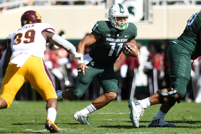 Michigan State's Connor Heyward runs for a gain during the first quarter on Saturday, Sept. 29, 2018, at Spartan Stadium in East Lansing.