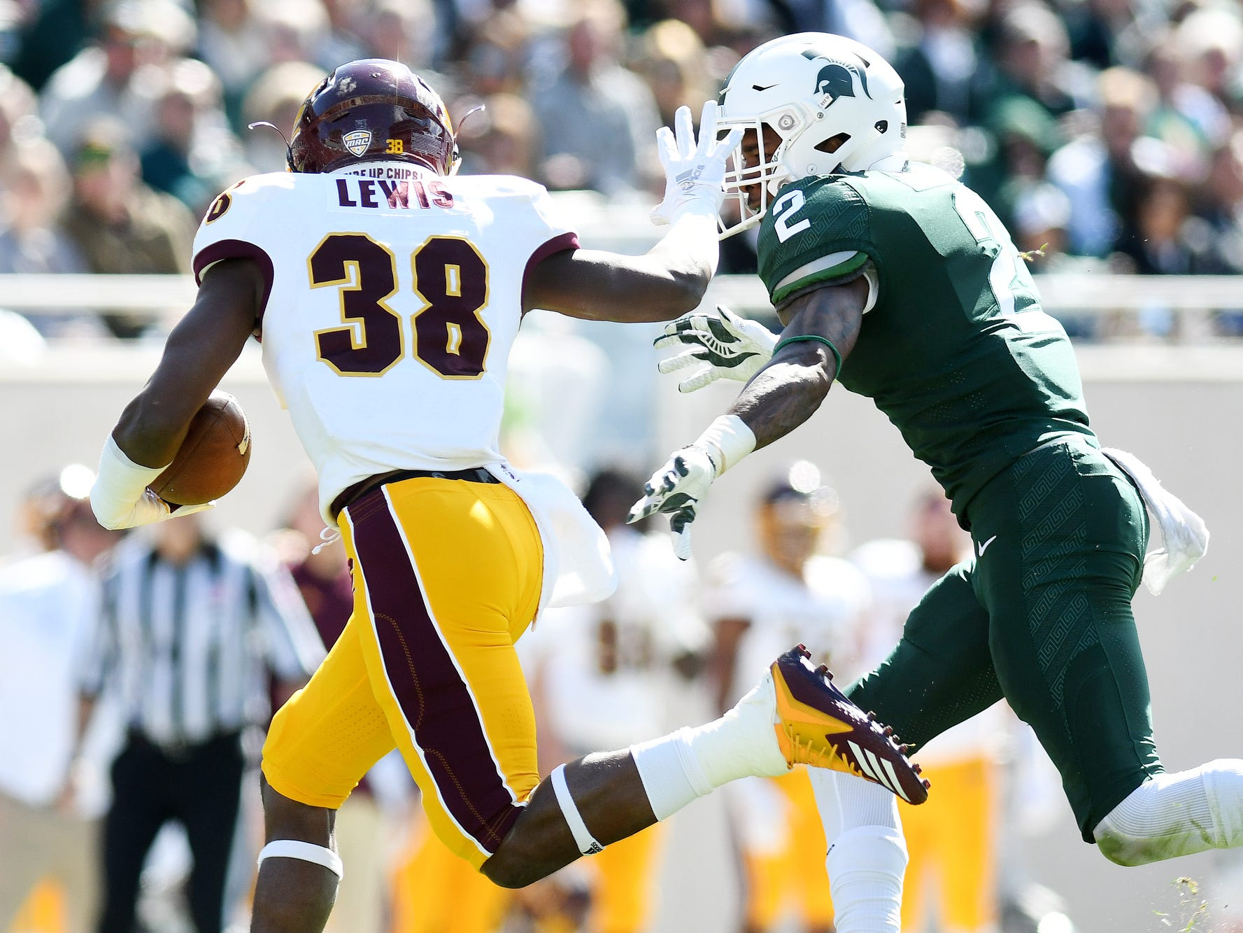 Michigan State's Justin Layne, right, closes in on Central Michigan's Kobe Lewis during the second quarter on Saturday, Sept. 29, 2018, at Spartan Stadium in East Lansing.