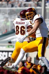 Central Michigan's Tony Poljan, right, and Bernhard Raimann (86) celebrate Poljan's touchdown reception against Michigan State during the fourth quarter of an NCAA college football game, Saturday, Sept. 29, 2018, in East Lansing, Mich. Michigan State won 31-20.