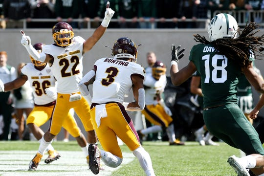 Central Michigan's Sean Bunting, center, intercepts a pass intended for Michigan State's Felton Davis III, right, during the first quarter on Saturday, Sept. 29, 2018, at Spartan Stadium in East Lansing.
