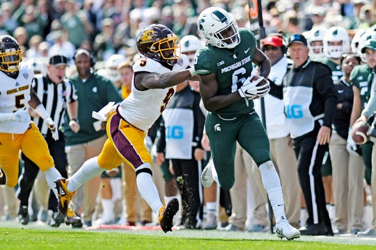 Michigan State's David Dowell, right, is pushed out of bounds by Central Michigan's Damon Terry after Dowell's interception during the second quarter on Saturday, Sept. 29, 2018, at Spartan Stadium in East Lansing.