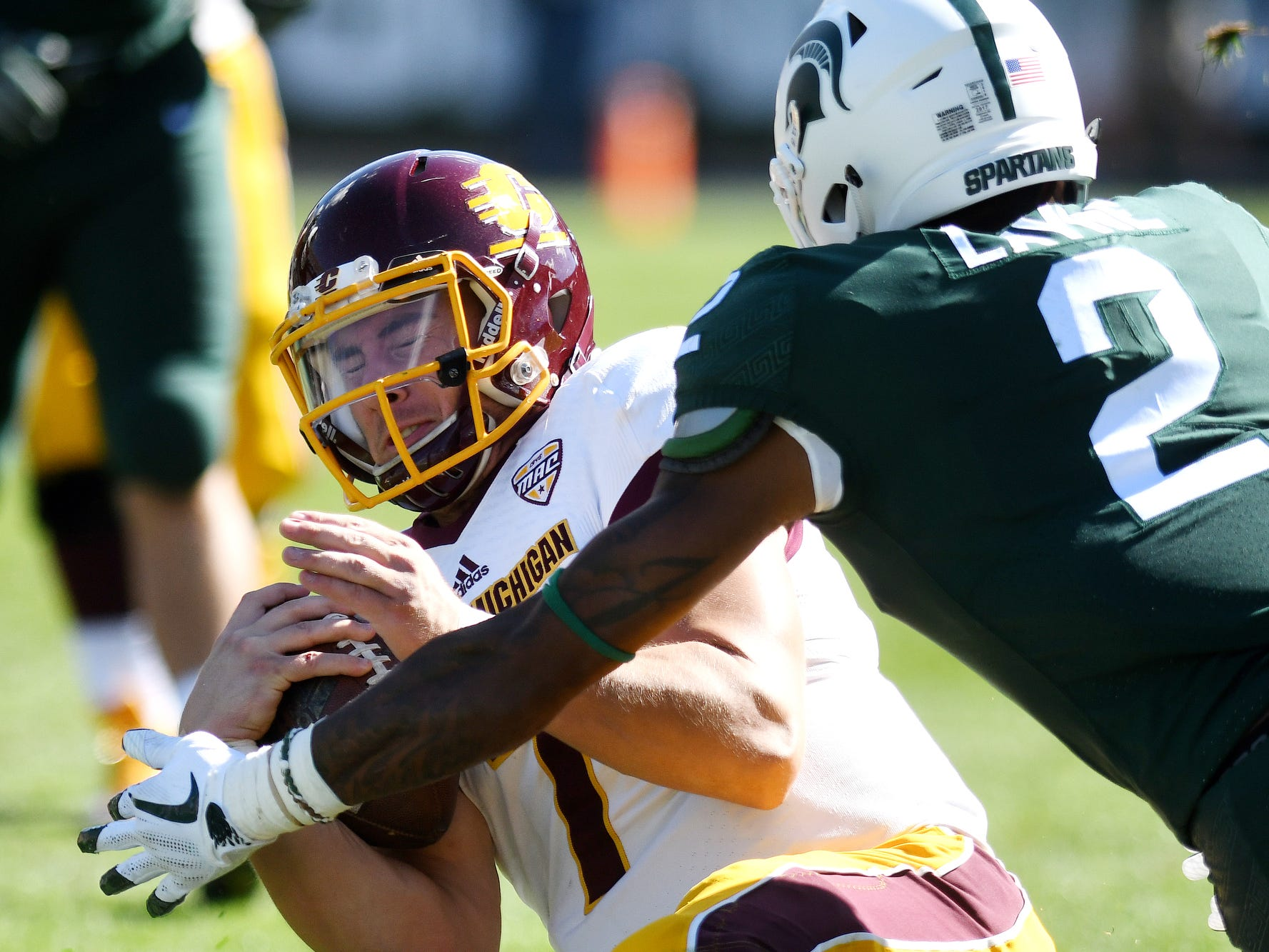 Michigan State's Justin Layne, right, is penalized for a late hit on Central Michigan quarterback Tommy Lazzaro during the fourth quarter on Saturday, Sept. 29, 2018, at Spartan Stadium in East Lansing.