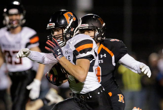 Reedsville's Brandon Stelzer (34) runs for a large gain before being taken down by Cedar Grove-Belgium's Max Ford (9) during a Big East Conference game at Cedar Grove-Belgium High School on Sept. 28.