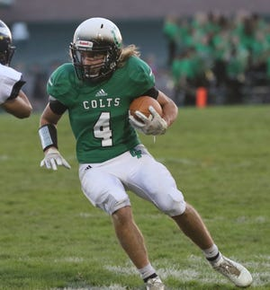 Clear Fork's Zach Homerick runs with the ball while playing against River Valley at home earlier in the season.