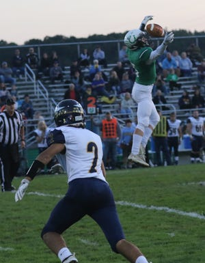 Clear Fork's Caden Flynn attempts to catch a pass while playing against River Valley at home earlier in the season
