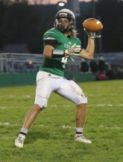 Clear Fork's Zack Homerick throws a pass into the end zone while playing against River Valley at home on Friday night.