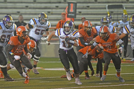 Lexington's Kaden Berry finds some room to run at Arlin Field during a game with the Mansfield Senior Tygers last season.