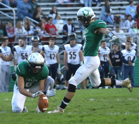 Clear Fork's Gabe Blauser kicks the ball while playing against River Valley at home earlier in the season.
