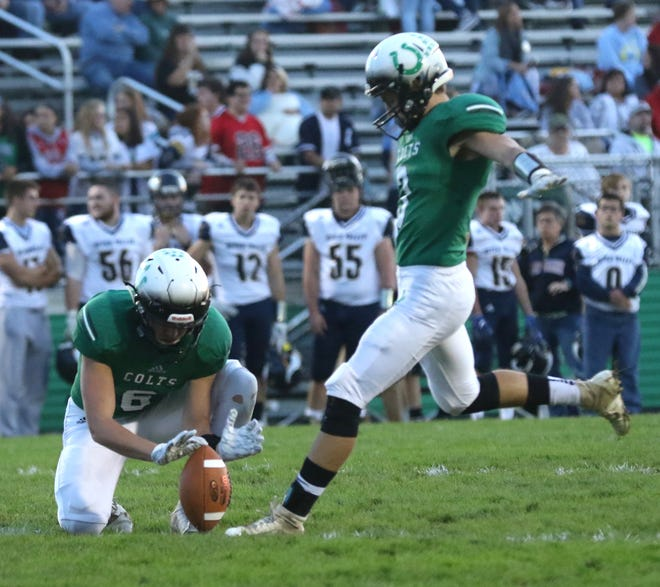 Clear Fork's Gabe Blauser kicks the ball while playing against River Valley at home on Friday night.
