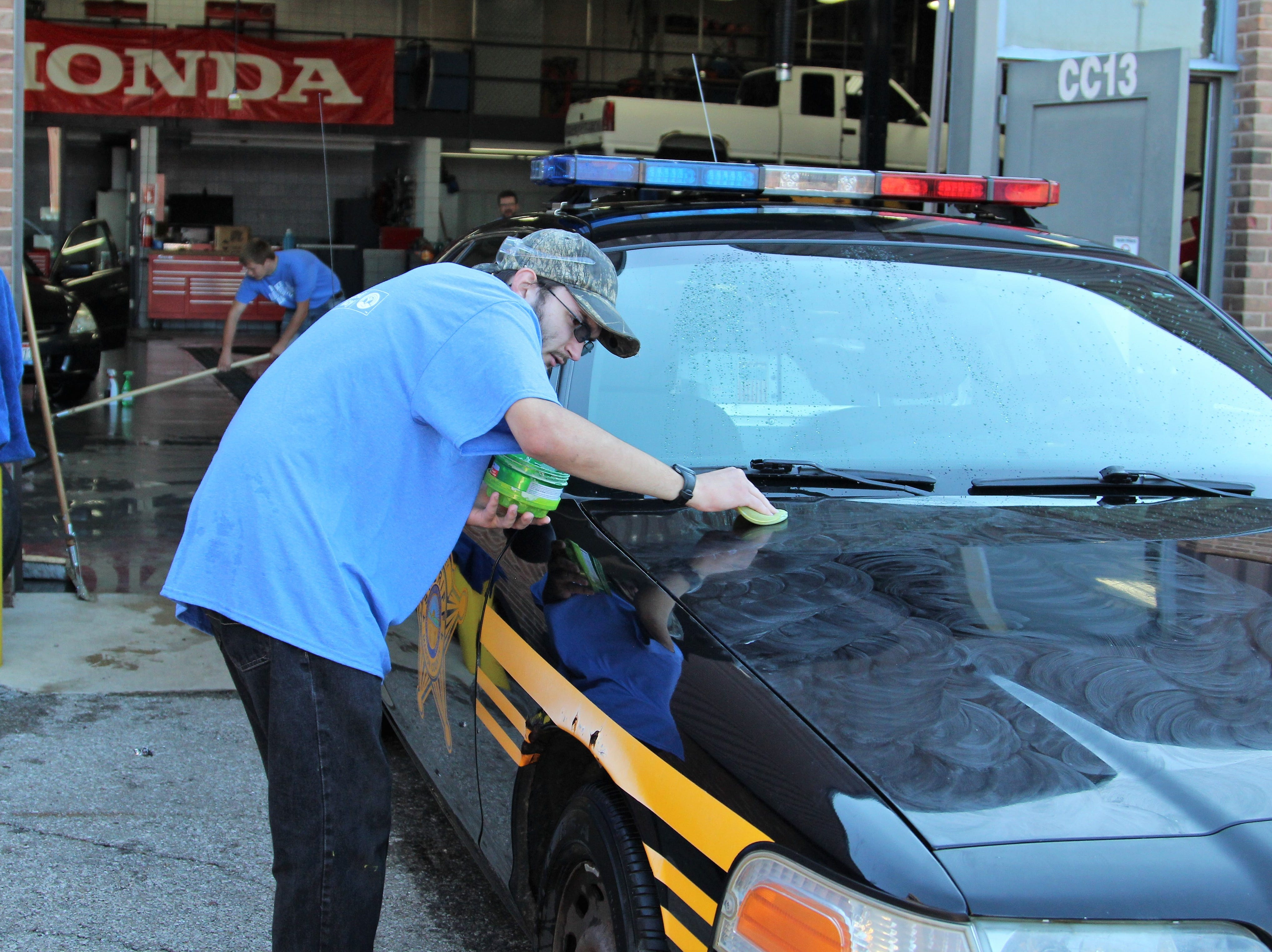 Auto tech students at Tri-Rivers Career Center spent most of Friday morning and early afternoon vacuuming, washing and waxing cars that came from the Marion County Sheriff's office as well as the Turning Point shelter.
