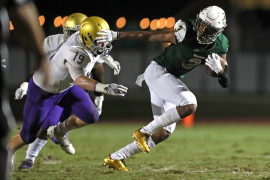 Briarcrest's Reggie Neely tries to break away from Christian Brothers' Andrew Martin during their game on Sept. 28, 2018.
