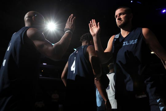 Chandler Parsons, right, high-fives teammates during the Grizzlies open practice and scrimmage for fans at the FedExForum on Saturday, Sept. 29, 2018.