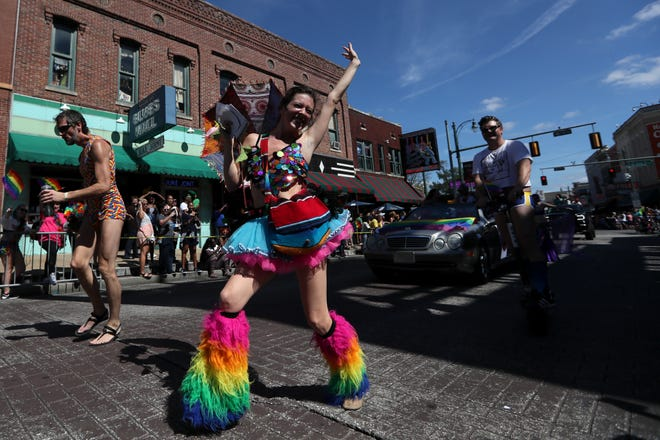 Revelers strut through Beale Street during the Mid-South Pride parade in Downtown Memphis Saturday.