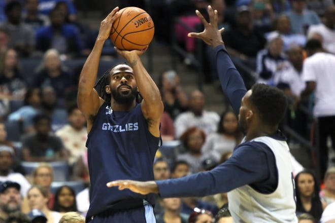 Mike Conley shoot a jumper over Shelvin Mack during the Grizzlies open practice and scrimmage for fans at the FedExForum on Saturday, Sept. 29, 2018.