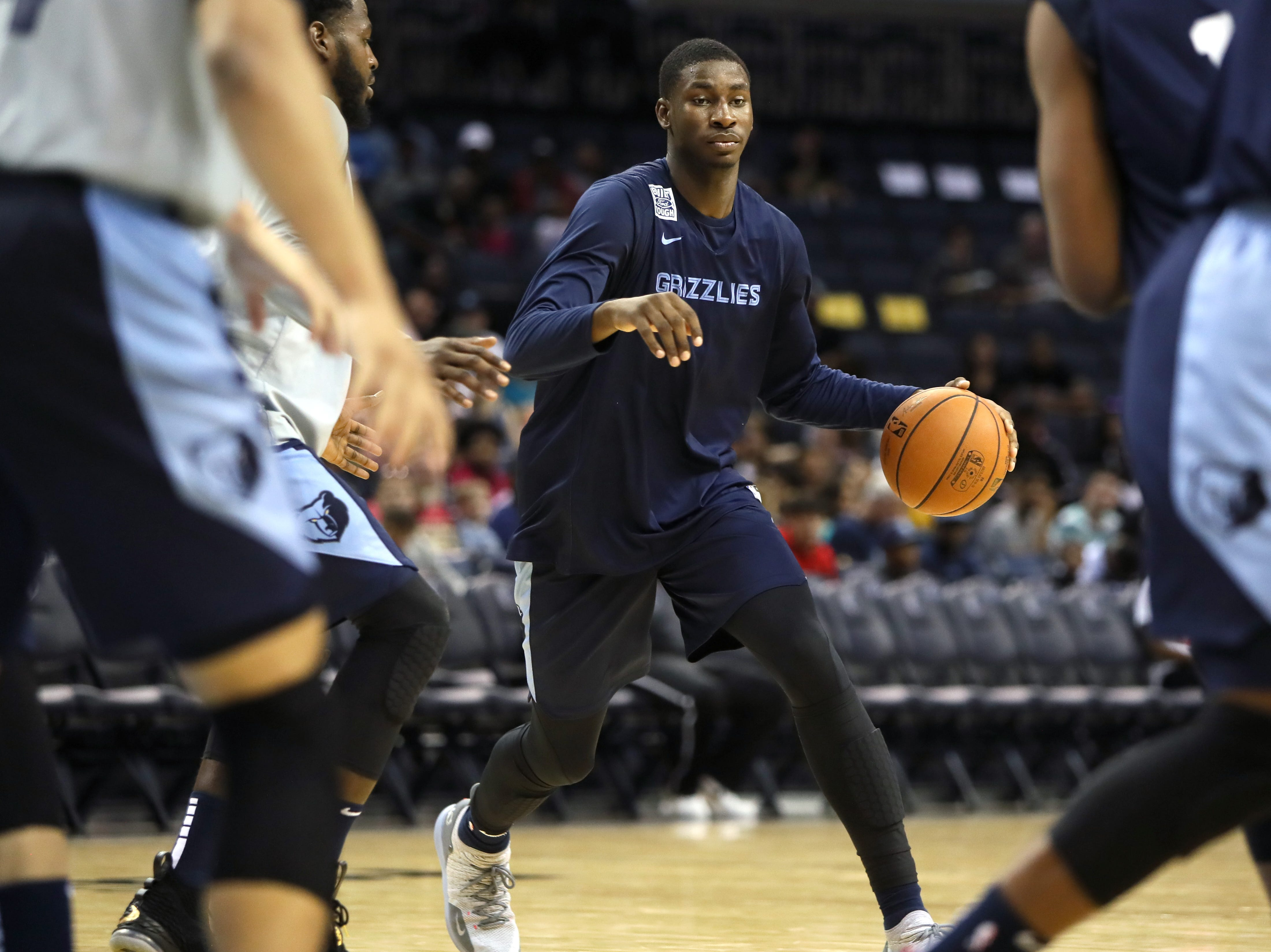 Jaren Jackson Jr. weaves through defenders during the Grizzlies open practice and scrimmage for fans at the FedExForum on Saturday, Sept. 29, 2018.
