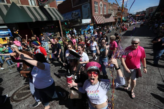 """People walk along Beale Street during the Mid-South Pride in Downtown Memphis Saturday. """"Pride is about loving and being accepting of who you are,"""" said Mid-South Pride president Vanessa Rodley."""