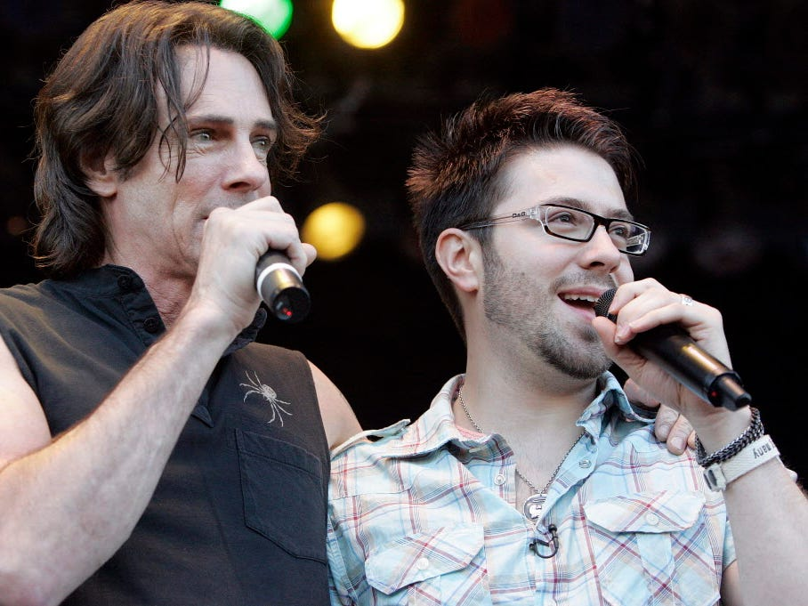 "Danny Gokey (right) is joined on stage by singer Rick Springfield prior to Gokey's concert filmed for ""American Idol."""