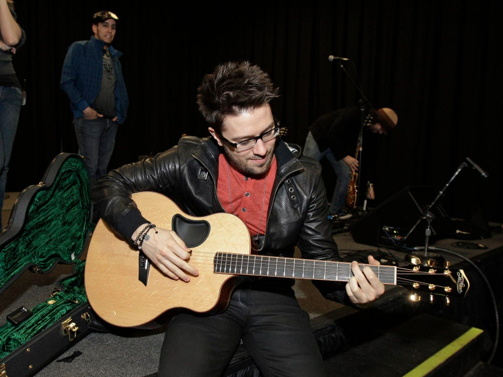 "Danny Gokey practices a Rascal Flatts song between breaks during a rehearsal in Nashville with the band that he will tour with after his debut album ""My Best Days"" is released. He often has 12-15 hour days as he prepares for the media requests surrounding his country album debut."