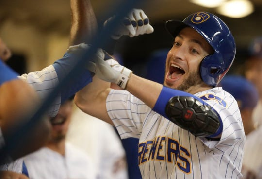 Ryan Braun is congratulated by his teammates in the Brewers dugout after his solo homer in the first inning tied the game against the Tigers on Friday night.