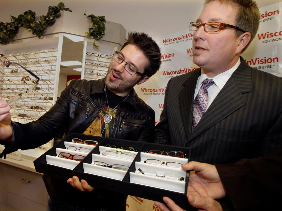 """I wore these glasses on American Idol,"" exclaimed  new country artist Danny Gokey  as he talks with Darren Horndasch, Wisconsin Vision's president and CEO, during a meet and greet with fans during and promotional tour at the new Wisconsin Vision store in Glendale,  Wednesday, November 17, 2010. Gokey is donating his old glasses for auction to raise money for a free vision care program for children in need. He also had an eyewear line with Wisconsin Vision."