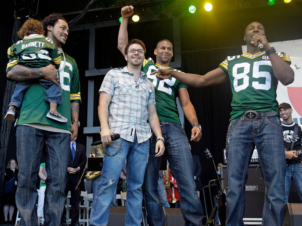 "Danny Gokey is wished ""good luck"" on ""American Idol"" by Green Bay Packers Nick Barnett (left), Ruvell Martin and Greg Jennings prior to his concert Friday, May 8, 2009 at the Summerfest grounds in Milwaukee."